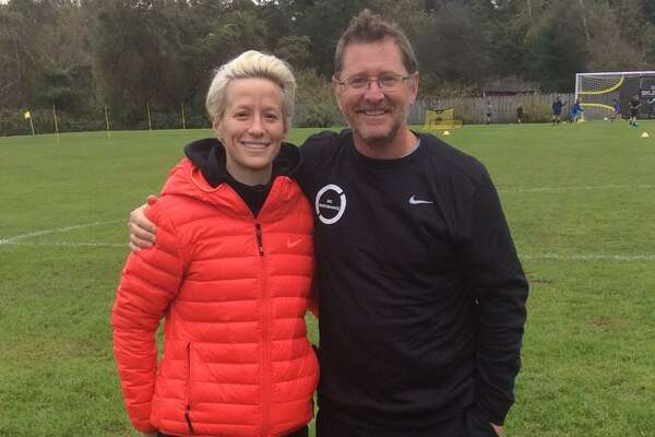 Megan Rapinoe, a member of the U.S. women?'s national soccer team, left, held a soccer clinic at Sacred Heart Greenwich on Saturday. Greenwich High School boys soccer coach Kurt Putnam, right, is one of the coordinators of Cardinals Soccer Camps, who was affiliated with the clinic.
