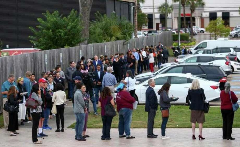 People wait in line for early voting at the Metropolitan Multi-Services Center on Monday in Houston. Photo: Godofredo A. Vasquez