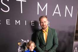 "Houston native actor Gavin Warren wears an electric blue, velvet blazer with star-printed lining and cuff links and galaxy socks by Balani Custom Clothiers for the screening of ""First Man,"" starring Ryan Gosling."
