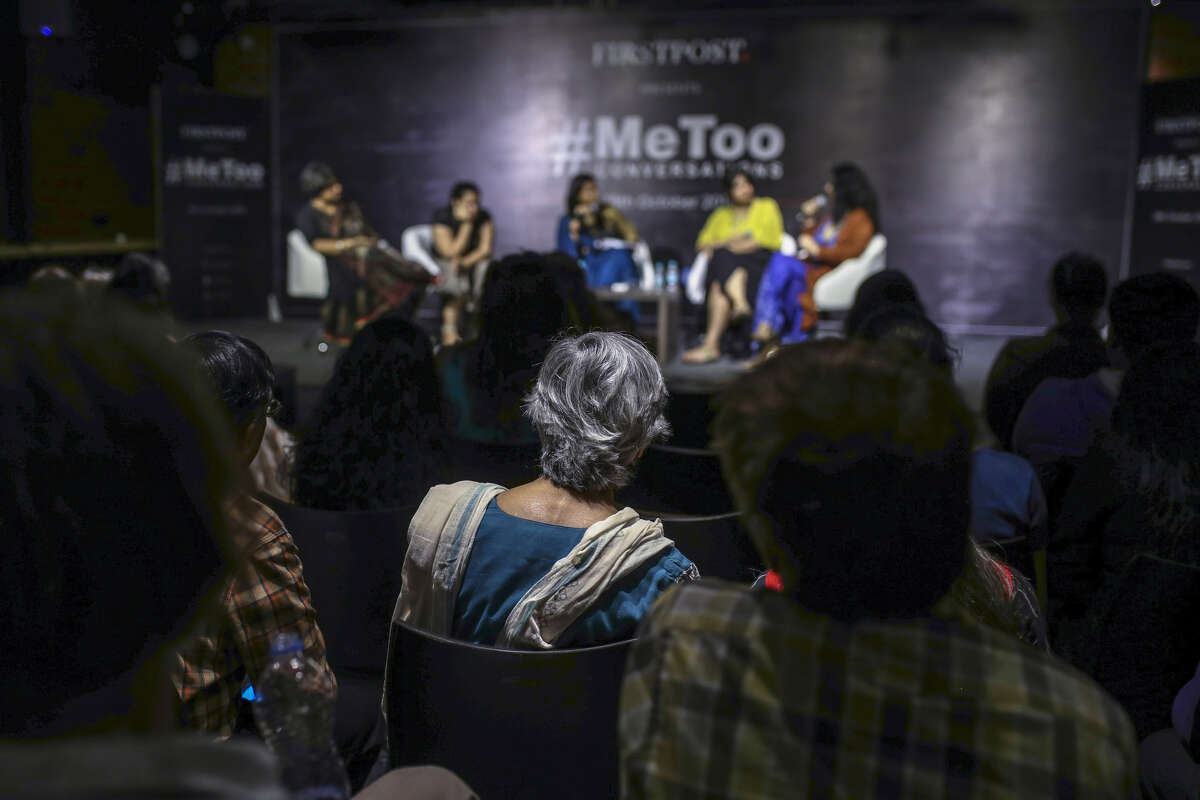 People listen to a discussion with Sandhya and Mahima at a #MeToo event in Mumbai.