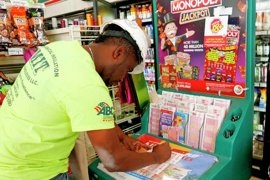 Jean Pierre fills out several Mega Millions lottery tickets for purchase. No one won the $1 billion jackpot in Saturday night's drawing, which means the top prize for tonight's Mega Millions drawing would be the largest lottery jackpot in U.S. history. John Raoux | AP