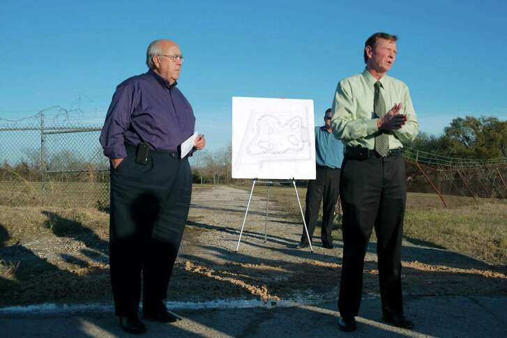 In a 2013 ceremony, then-Deer Park Mayor Wayne Riddle, left, and Mike Talbott, then Harris County Flood Control District's executive director, officially start construction of Patrick's Bayou detention pond near the 600 block of Luella and Texas 225. Creation of that 32-acre detention pond is credited with helping limit flooding during Hurricane Harvey.