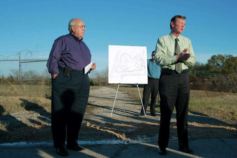 In a 2013 ceremony, then-Deer Park Mayor Wayne Riddle, left, and Mike Talbott, then Harris County Flood Control District's executive director, officially start construction of Patrick's Bayou detention pond near the 600 block of Luella and Texas 225. Creation of that 32-acre detention pond is credited with helping limit flooding during Hurricane Harvey. Photo: Kirk Sides / The Broadcaster / The Broadcaster