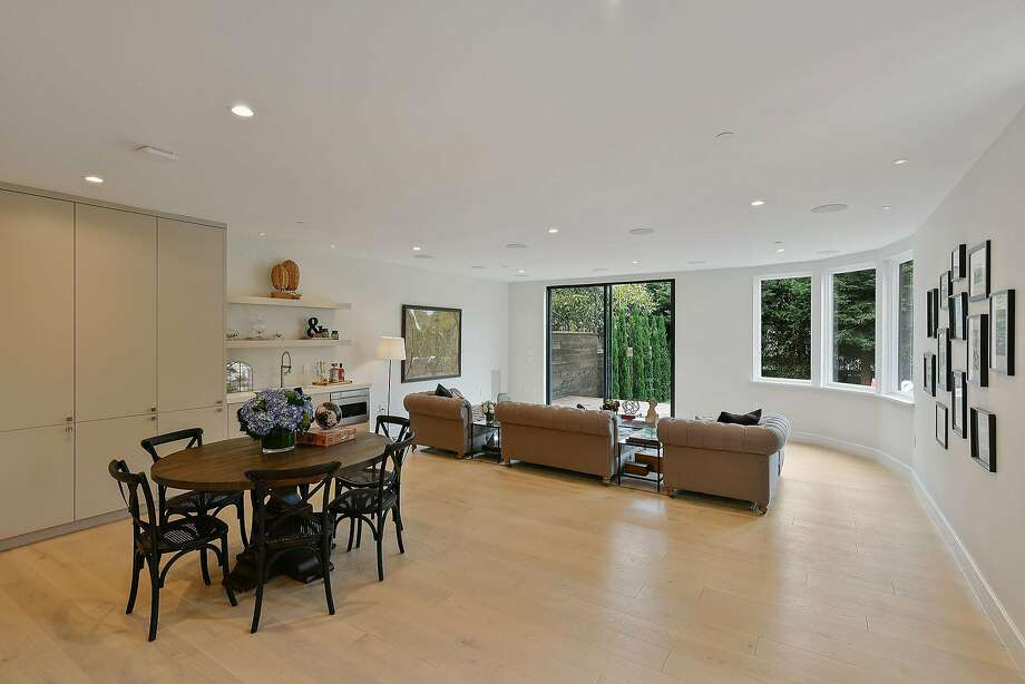 A family room on the lower level opens to the landscaped backyard. Photo: Open Homes Photography
