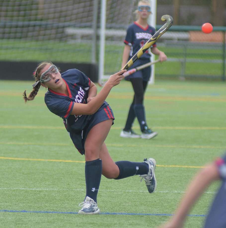 Greens Farms Academy senior Lucy Holzinger, a resident of Westport, smacks the ball up the field during a field hockey game last week in Westport. Photo: Greens Farms Academy Athletics