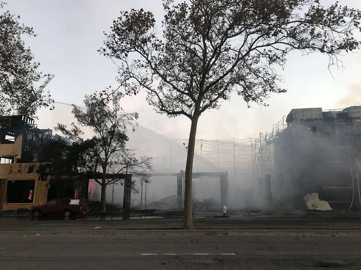 A huge fire broke out at a construction site in Oakland early Tuesday destroying six buildings that were part of a new condo project, authorities said