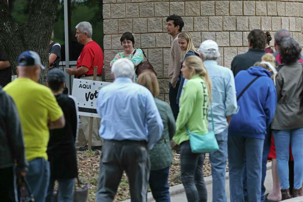People line up for early voting in the November midterm elections at Brook Hollow Library, Monday, Oct. 22, 2018. Bexar County has 43 locations for early voting which is scheduled to run through November 2.