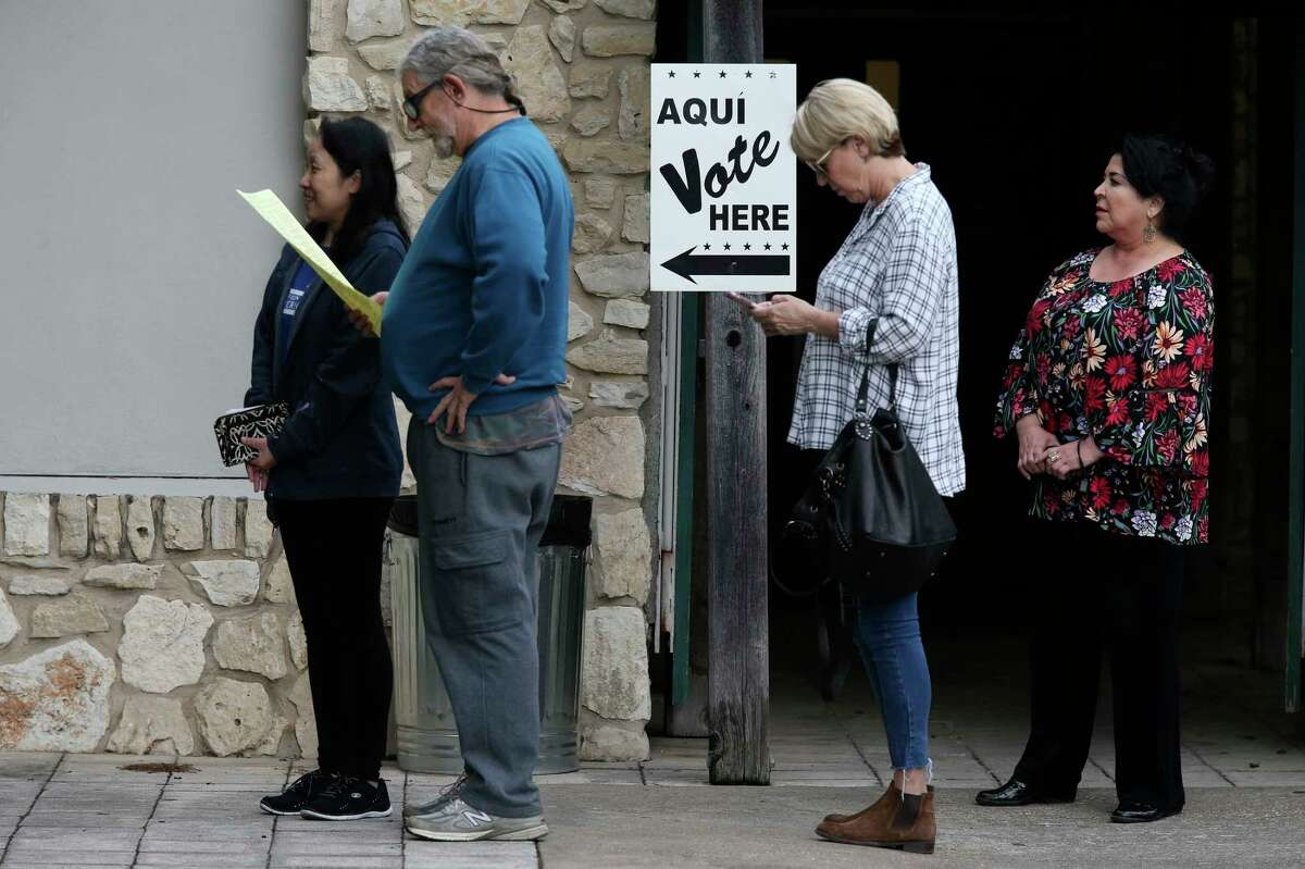 People line up for early voting at Lion's Field in the November midterm elections, Monday, Oct. 22, 2018. Bexar County has 43 locations for early voting which is scheduled to run through November 2.
