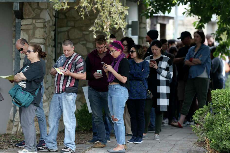 People line up for early voting in the November midterm elections at Lion's Park, Monday, Oct. 22, 2018. Bexar County has 43 locations for early voting which is scheduled to run through November 2.