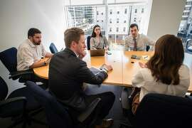 "Thomas Peters, right, the chief executive of uCampaign, which develops apps for Republican candidates and right-leaning causes, during a meeting with staff in Washington, Sept. 28, 2018. Conservatives ""feel like the big social platforms, Facebook and Twitter, are not sympathetic to their views,"" said Peters. (Andr� Chung/The New York Times)"