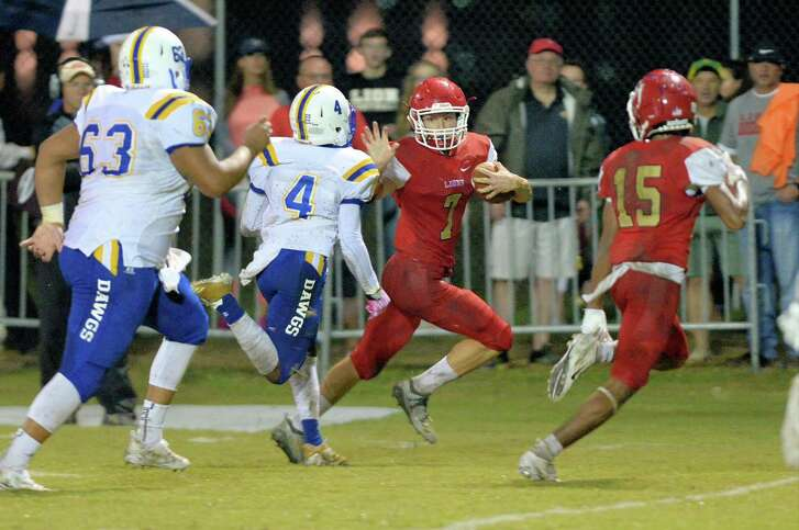 Jake Williams (7) of St. John XXIII carries the ball in the second quarter of a high school football game between the St. John XXIII Lions and the Beaumont Kelly Bulldogs on Friday, Oct. 19, at St. John XXIII in Katy.