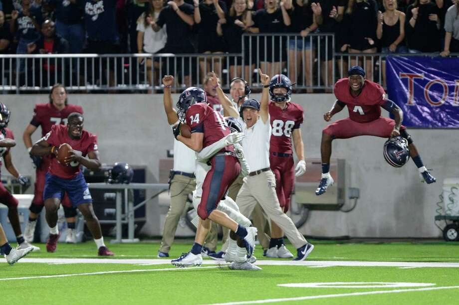 Colby Huerter (14) of Tompkins picks off a pass intended for John Harrington (10), putting the brakes on the final attempt by Seven Lakes to take the lead in the fourth quarter of a high school football game between the Tompkins Falcons and Seven Lakes Spartans on Friday, September 28, 2018 at Legacy Stadium, Katy, TX. Photo: Craig Moseley, Houston Chronicle / Staff Photographer / ©2018 Houston Chronicle