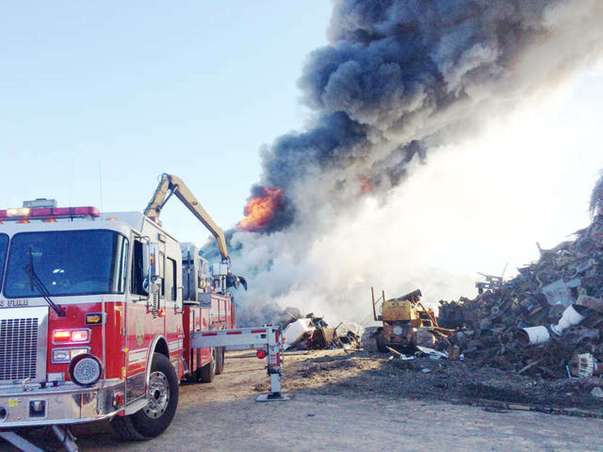 An Alton Fire Department truck sets up to help fight the blaze at Maw Salvage on Fosterburg Road in Brighton. A total of 12 departments provided aid in fighting the fire at the metal recycling business.