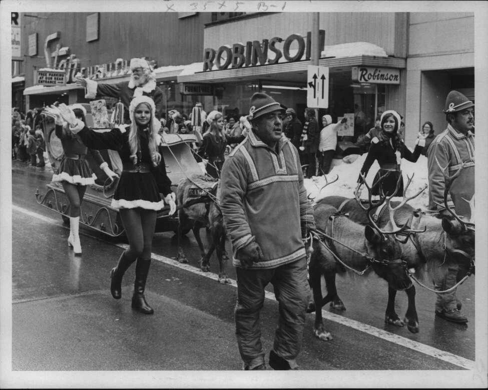Reindeer pull Santa's sleigh in Schenectady, New York Christmas parade. November 28, 1971 (Raymond B. Summers/Times Union Archive)