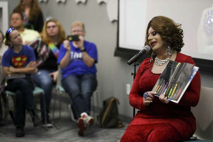 """Divinity Masters reads """"Red: A Crayon's Story"""" by Michael Hill during the Say YAAAS to Reading event at the Advanced Learning Library in Wichita, Kan. The event featured local drag queens reading books to children."""