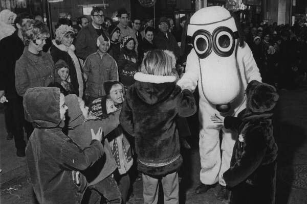 Snoopy character greets children during Schenectady, NY parade. October 13, 1976 (Paul D. Kniskern Sr./Times Union Archive)