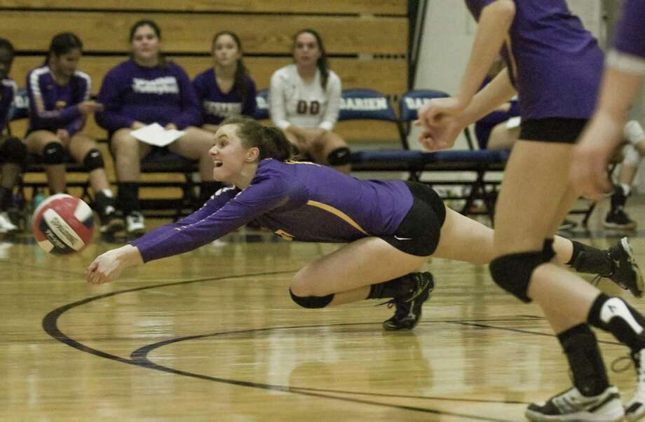 Westhill's Betsy Sachs tries to dig out the ball in a 3-0 sweep of Darien Monday in Darien. Photo: Scott Mullin / For Hearst Connecticut Media / The News-Times Freelance