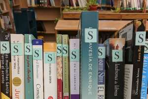 "Books in Spanish are marked with an ""S"" at West Haven High School's media center, which is seeking donations from the public."