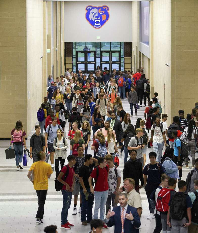 A Conroe ISD professional social services liaison position is relatively new— it began at the beginning of the 2018-19 school year and is partly funded by a Homeless Children and Youth grant from the Texas Education Agency. The staff member visits identified homeless and unaccompanied youth students and helps connect them and their families to community resources. Here, Grand Oaks High School students walk the halls of the newly opened Conroe ISD school on the first day of school on Wednesday, Aug. 15, 2018, in Spring. Photo: Jason Fochtman, Staff Photographer / Staff Photographer / © 2018 Houston Chronicle