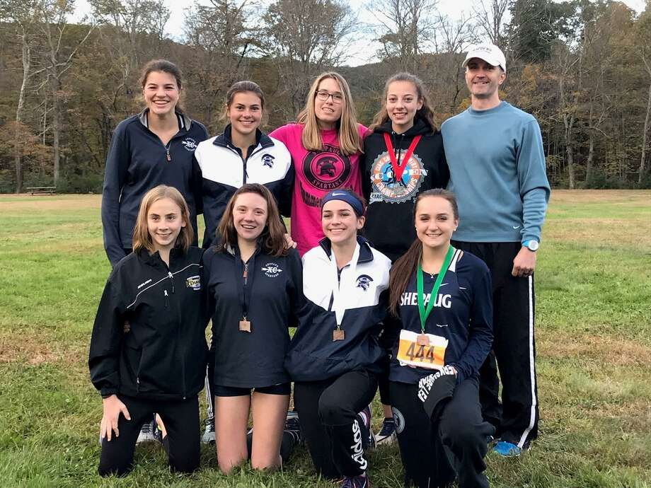 Shepaug Berkshire League Champs. First row: Peyton Nash, Erin McGrath, Eilish Foy and Aileen Rosa. Second Row: Jolie Grazia, Claire Buckley, Tiffany Horton, Eilsa Afiouni and Coach John Spear Photo: Contributed Photo / The News-Times Contributed