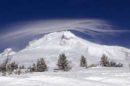FILE - In this Dec. 13, 2009, file photo, a cloud forms over Mount Hood as seen from Government Camp, Ore. Researchers say active fault lines on Mount Hood could potentially trigger a 7.2 magnitude quake that could reach Portland. (AP Photo/Don Ryan, File)