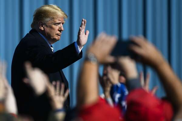 President Donald Trump waves to a crowd before leaving a campaign rally on Saturday, Oct. 20, 2018 in Elko, Nev. (AP Photo/Alex Goodlett)