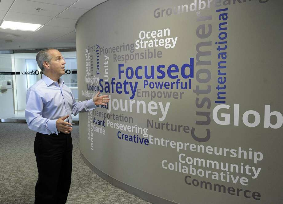 Cosmo Alberico, COO and CFO of Odyssey Logistics & Technology in Danbury, talks about a wall filled with inspirational words in a hallway of Odyssey's office space at the Matrix Conference Center in Danbury. Photo: Carol Kaliff / Hearst Connecticut Media / The News-Times
