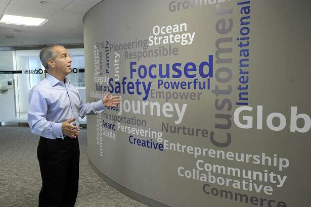 Cosmo Alberico, COO and CFO of Odyssey Logistics & Technology in Danbury, talks about a wall filled with inspirational words in a hallway of Odyssey's office space at the Matrix Conference Center in Danbury, Tuesday, Sept. 12, 2017.