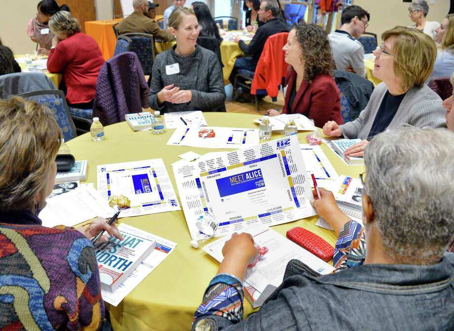 Community stakeholders and local non-profit agencies participate in a simulated ALICE Household Survival Budget as the United Way of the Greater Capital Region hosts a meeting to address priorities in the areas of basic needs and updates United Way of NYS ALICE data Tuesday Oct. 23, 2018 in Albany, NY.  (John Carl D'Annibale/Times Union) Photo: John Carl D'Annibale, Albany Times Union / 20045251A
