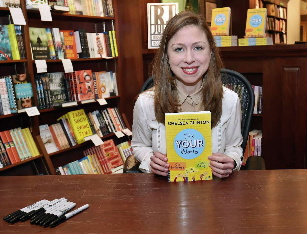 """Chelsea Clinton poses for the media before a book signing for """"It's Your World,"""" Wednesday, April 5, 2017, at R.J. Julia Booksellers on Main Street in Madison. (Catherine Avalone/New Haven Register)"""