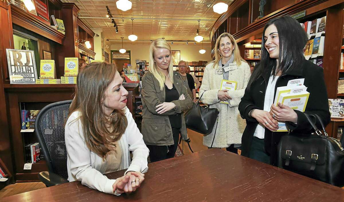 """Chelsea Clinton was a recent luminary at the bookstore. Here she signs her book, """"It's Your World"""" for Madison residents Emily Young, Mega Smith and Jill Bergson last year at R.J. Julia Booksellers on Main Street in Madison."""