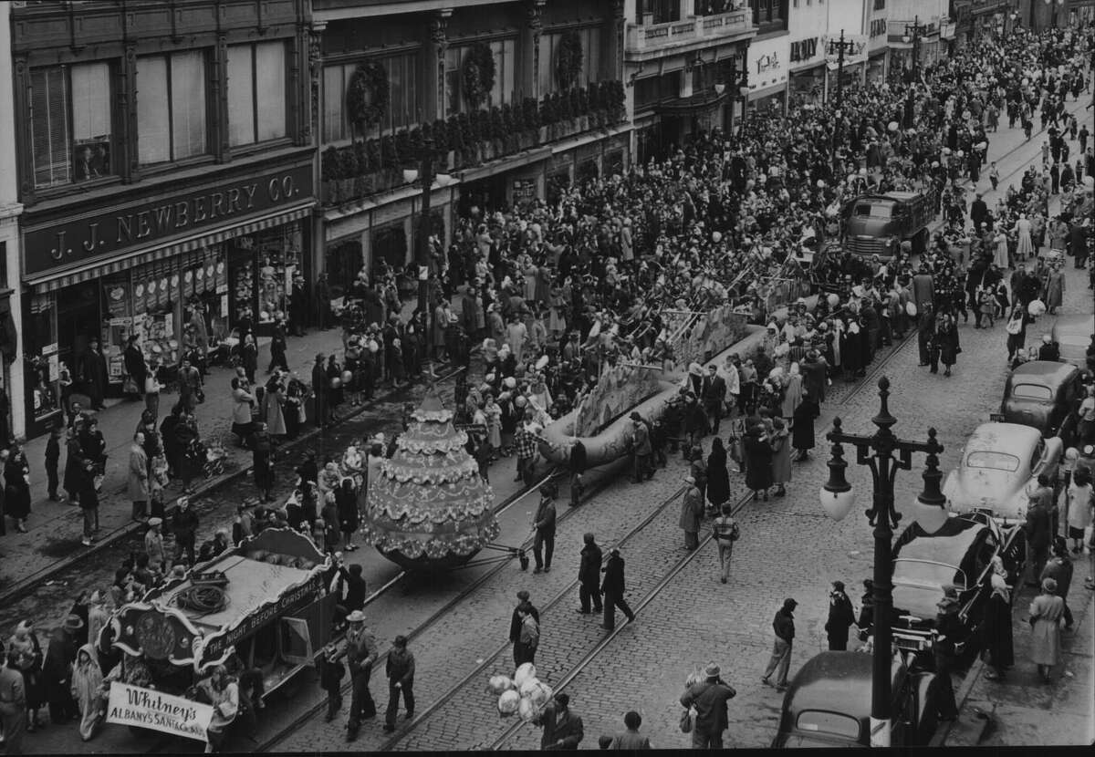 On this date, November 18, 1950. Floats go down Pearl Street during Whitney's Christmas Parade in Albany, New York. November 18, 1950.