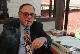 San Francisco Giants radio play-by-play broadcaster Hank Greenwald enjoys one of his always present Dunhill cigars in the broadcast booth atop 3Com Park after announcing his retirement in San Francisco, Tuesday, Aug. 27, 1996, prior to the San Francisco Giants game against Philadelphia. Greenwald, who has worked 16 seasons for the Giants, will retire at the end of the season. (AP Photo/Eric Risberg) ALSO RAN 4/21/99, MN