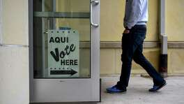 A resident arrives for early voting at a polling location in San Antonio on Oct. 22. Voting is the cure for what ails us.