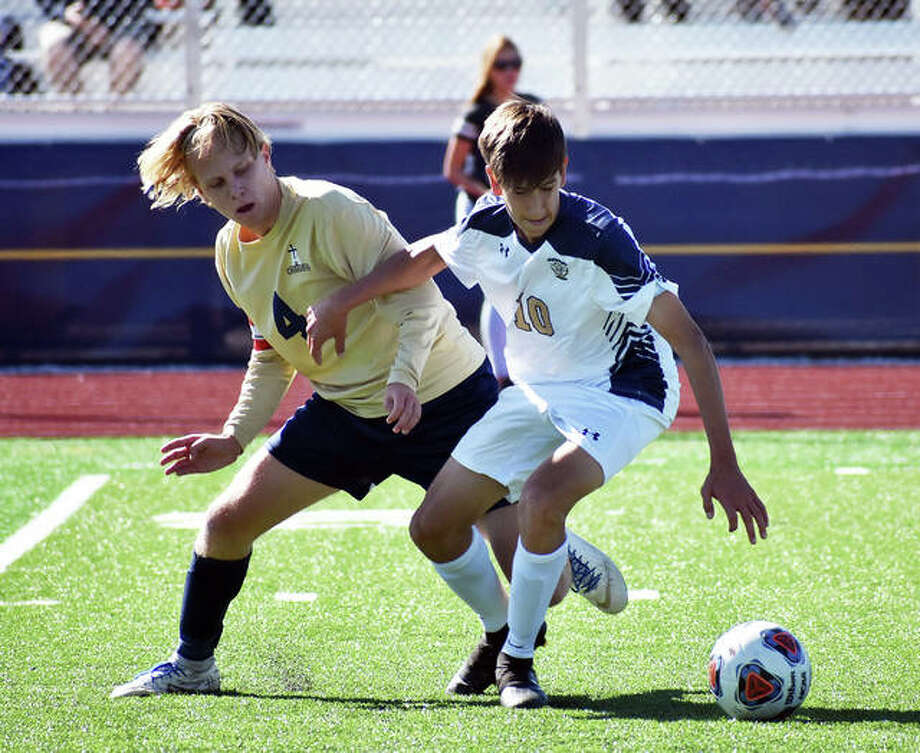 Father McGivney's Zach Hunter, right, battles with Althoff's Mitchell Kidd for possession during the first half of Saturday's sectional championship game in Belleville. Photo: Matt Kamp/Intelligencer
