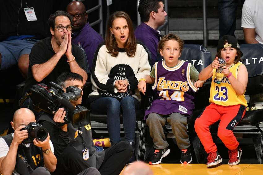 LOS ANGELES, CA - OCTOBER 22: Natalie Portman, her son Aleph Portman-Millepied and a friend attend a basketball game between the Los Angeles Lakers and the San Antonio Spurs at Staples Center on October 22, 2018 in Los Angeles, California. (Photo by Allen Berezovsky/Getty Images)