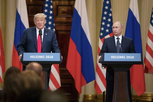 President Trump, left, speaks, as Vladimir Putin, Russia's president, listens during a news conference in Helsinki on July 16. The two are set to meet in November in France.