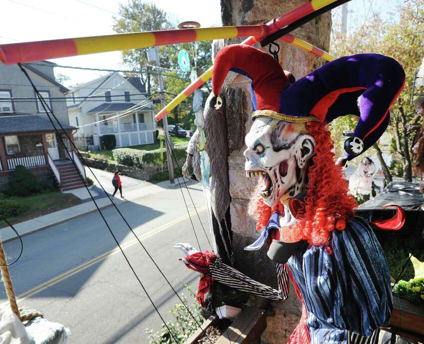 The front porch of Rosa Bruno's home is decorated with numerous ghoulish figures including a skeleton in a jester's outfit for Halloween on St. Roch Avenue in the Byram section of Greenwich, Conn., Tuesday, Oct. 23, 2018.