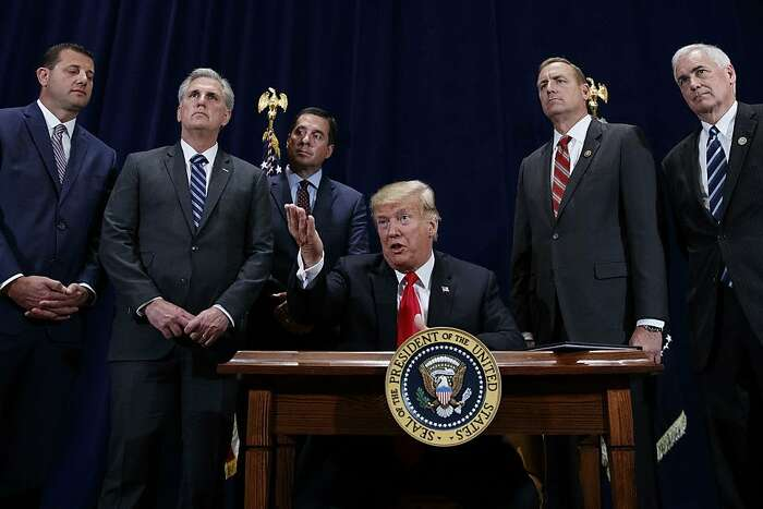 """President Donald Trump speaks during a ceremony to sign a """"Presidential Memorandum Promoting the Reliable Supply and Delivery of Water in the West,"""" Friday, Oct. 19, 2018, in Scottsdale, Ariz. Standing behind the president from left, Rep. David Valadao, R-Calif., Majority Leader Kevin McCarthy, R-Calif., Rep. Devin Nunes, R-Calif., Rep. Jeff Denham, R-Calif., and Rep. Tom McClintock, R-Calif.. (AP Photo/Carolyn Kaster)"""