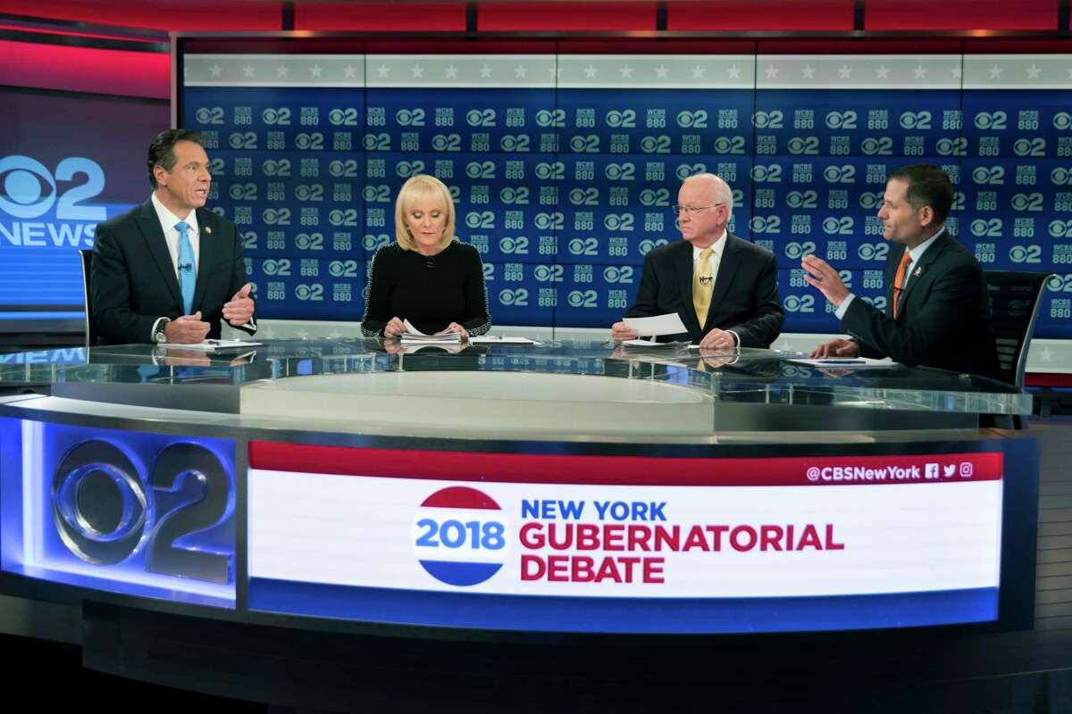 New York Gov. Andrew Cuomo, left, and Republican gubernatorial candidate Marc Molinaro, right, argue during the New York gubernatorial debate hosted by CBS 2 chief political correspondent Marcia Kramer, second from left, and WCBS Newsradio 880 reporter Rich Lamb, Tuesday, Oct. 23, 2018, in New York.