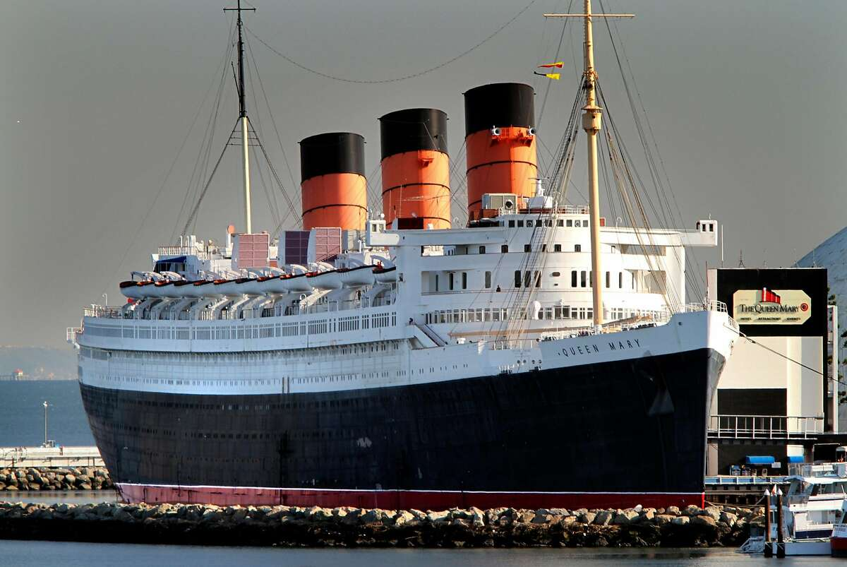 The Queen Mary at its permanent dock in Long Beach, Calif., on December 6, 2011. Throughout October and beyond, the opportunities to learn more about paranormal particulars aboard this 314-room ship are plentiful. (Don Bartletti/Los Angeles Times/TNS)