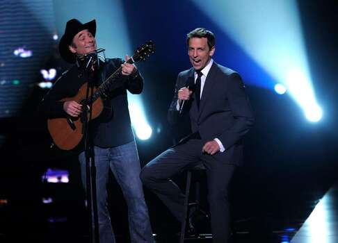 Clint Black, left, and Seth Mayer are seen at the ESPY Awards on Wednesday, July 14, 2010 in Los Angeles. (AP Photos/Chris Pizzello) Photo: Chris Pizzello