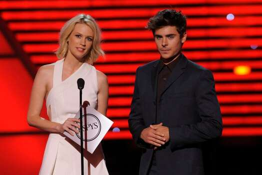 January Jones, left, and Zac Efron present the award for best U.S. male olympian at the ESPY Awards on Wednesday, July 14, 2010 in Los Angeles. (AP Photos/Chris Pizzello) Photo: Chris Pizzello