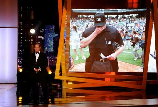Chris Berman introduces the presenters for best moment at the ESPY Awards on Wednesday, July 14, 2010 in Los Angeles. In background is a photograph of Major League Baseball Umpire Jim Joyce. (AP Photos/Chris Pizzello) Photo: Chris Pizzello