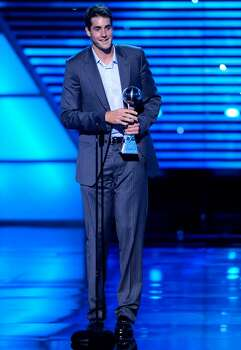 Professional tennis player John Isner accepts the award for best record breaking performance at the ESPY Awards on Wednesday, July 14, 2010 in Los Angeles. (AP Photos/Chris Pizzello) Photo: Chris Pizzello