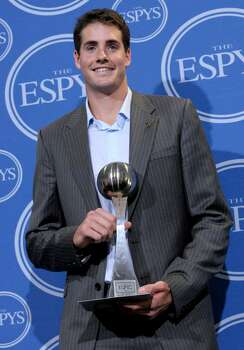 Tennis player John Isner poses with the award for Best Breakthrough Performance in the press room at the ESPY Awards on Wednesday, July 14, 2010 in Los Angeles. (AP Photo/Dan Steinberg) Photo: Dan Steinberg