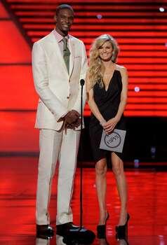 Basketball player Chris Bosh, left, and model Marisa Miller present the breakthrough athlete award at the ESPY Awards on Wednesday, July 14, 2010 in Los Angeles. (AP Photos/Chris Pizzello) Photo: Chris Pizzello