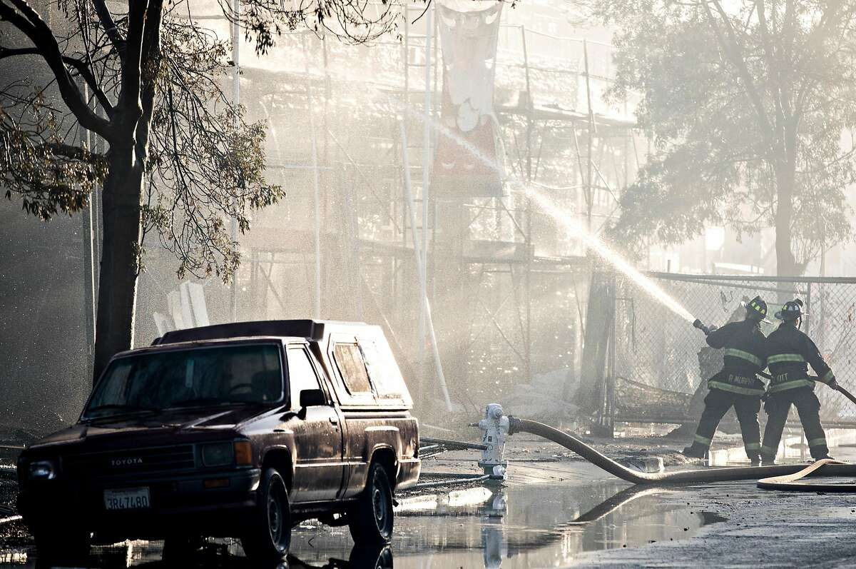 Crews battle a massive blaze that destroyed six apartment buildings in different phases of construction near West Grand Avenue and Filbert Street in Oakland, Calif. Tuesday, Oct. 23, 2018.