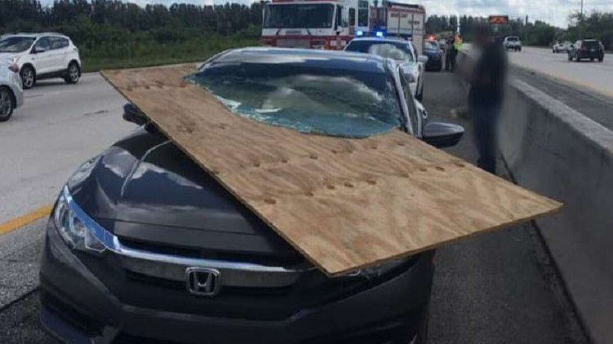 A massive piece of plywood narrowly struck a Florida driver after crashing through their windshield in October 2018.