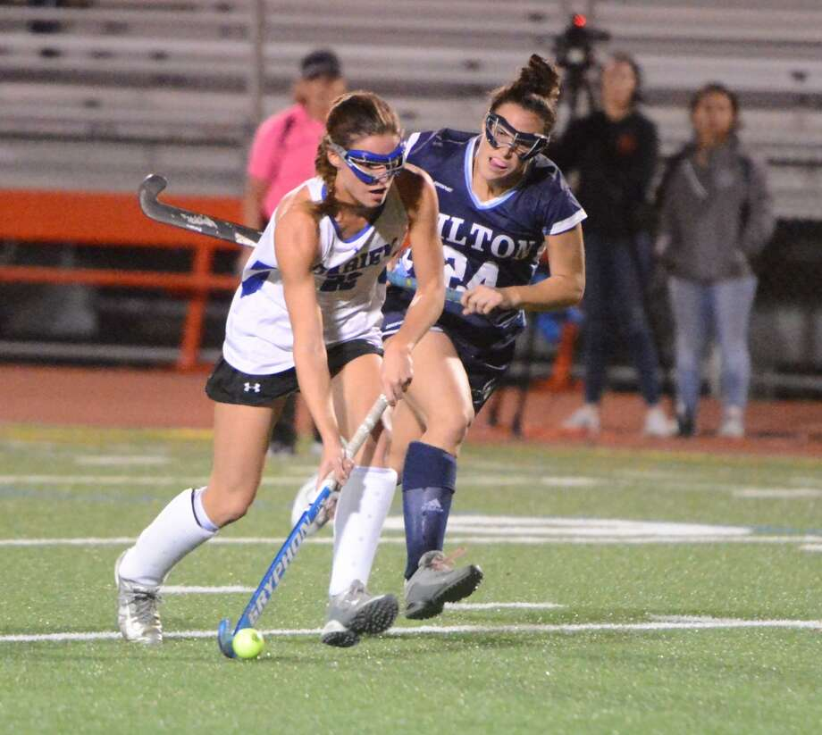 Darien's Katie Elders drives the ball against Wilton's Sophia Kaplan on Nov. 2. Photo: Alex Von Kleydorff / Hearst Connecticut Media / Norwalk Hour
